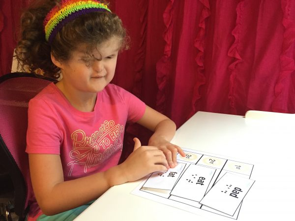 girl completing braille word activity
